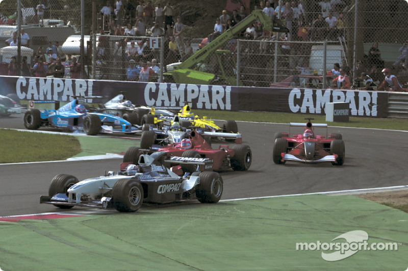 First corner: Juan Pablo Montoya leading Rubens Barrichello and Michael Schumacher