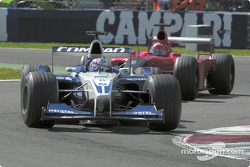 Juan Pablo Montoya in front of Michael Schumacher