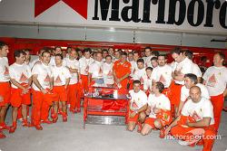 Team Ferrari celebrating Oreste Giovannini's last race