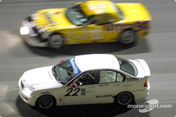 The #22 BMW 328i of David Chenoweth, Jerry Spangler, and Ray Mason races through the banking at Daytona as the #11 Corvette of Doug Goad and Devon Powell flashes by
