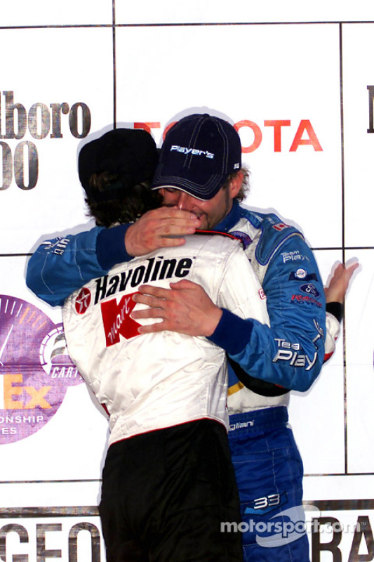 The podium: Cristiano da Matta and Alex Tagliani
