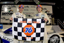 Butch Leitzinger and James Weaver celebrate their win in the Grand-Am season finale at Daytona