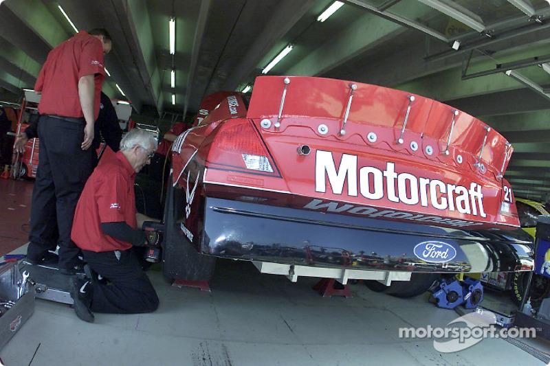 Woods Brothers crew members working on the Motorcraft Ford Taurus of Elliott Sadler