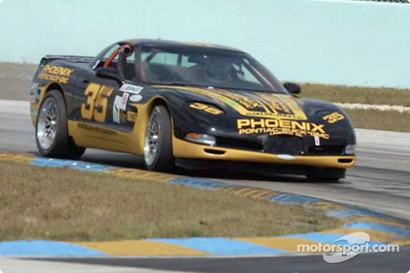 The #35 Phoenix American Motorsports Corvette takes a tight curve
