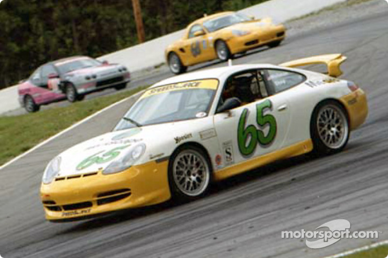 The #65 Speedsource Porsche leads several slower ST and C2K cars