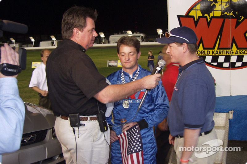 Rob Howden Editor and Publisher of Speedway USA Magazine presents the Speedway USA Magazine check to pole winner Michael Dowell -holding microphone is WKA President Randy Kugler