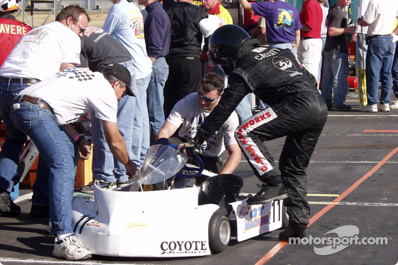 Justin Cassityís crew makes final adjustments to his kart during a pit stop as he climbs back into the cockpit
