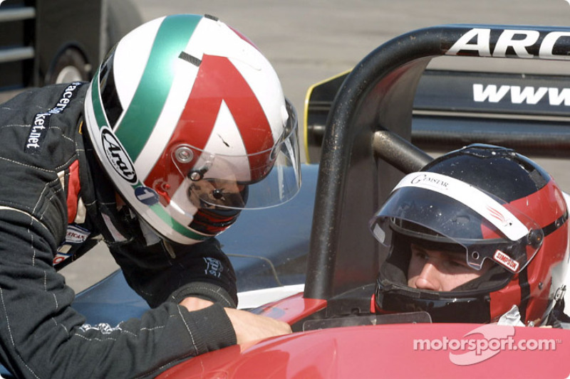 Andy Lally discusses strategy with his co-driver