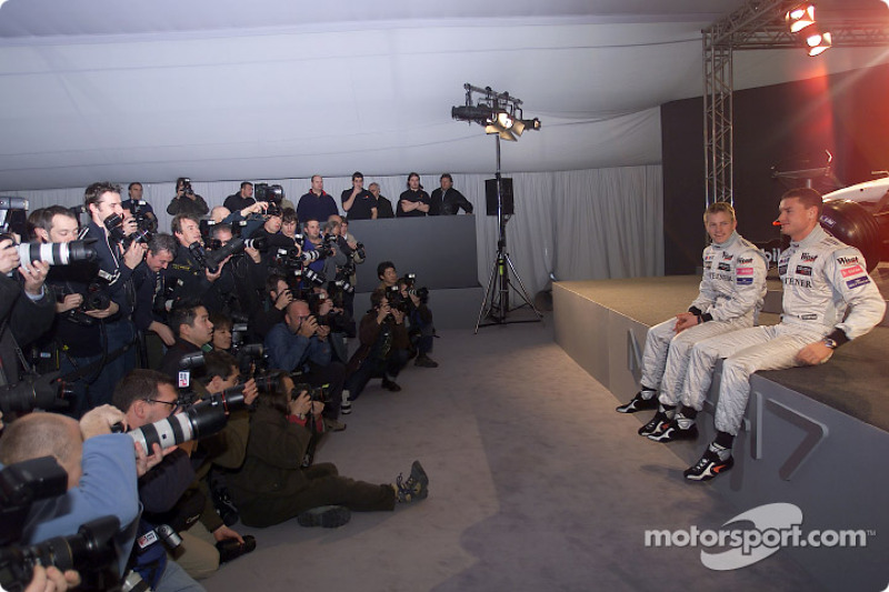 Kimi Raikkonen and David Coulthard in front of more than 300 media representatives attending the pre