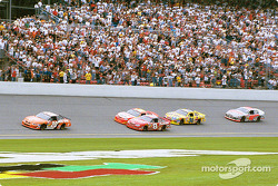 Tony Stewart leading Dale Earnhardt Jr. and Jeff Gordon
