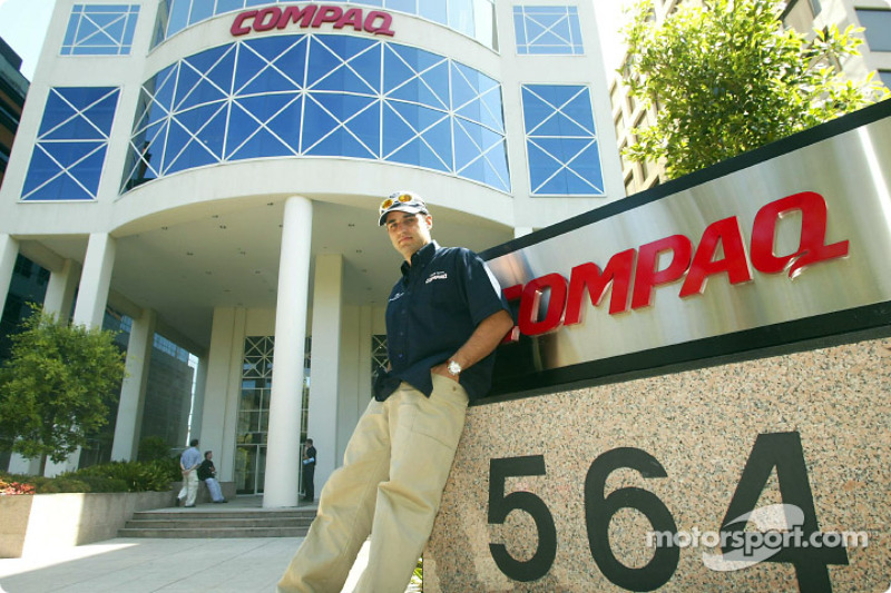 Compaq driver day: Juan Pablo Montoya relaxes outside the Compaq building in Melbourne