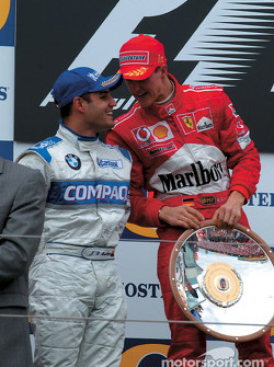 The podium: race winner Michael Schumacher with Juan Pablo Montoya