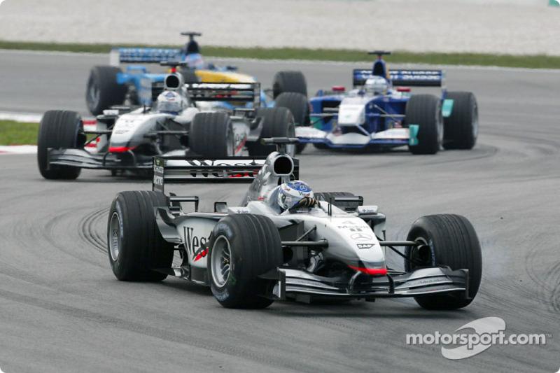 Kimi Raikkonen and David Coulthard