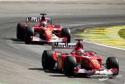 Rubens Barrichello about to pass Michael Schumacher
