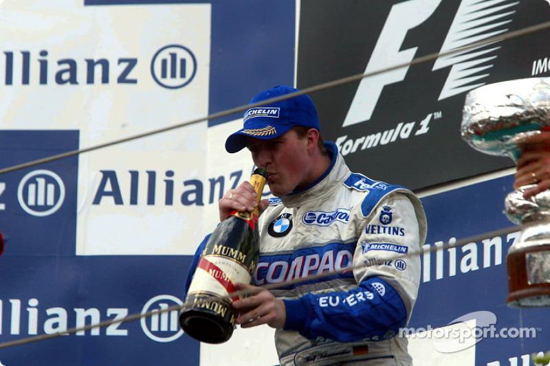 El podio: champaña para Ralf Schumacher