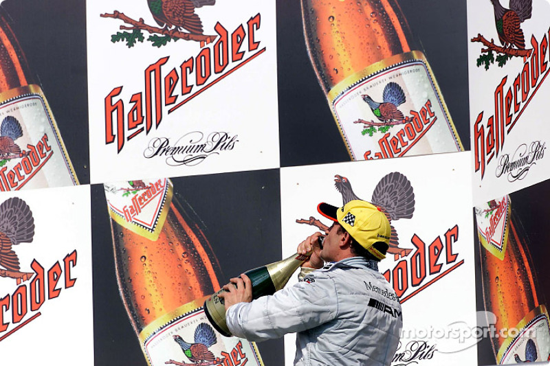 The podium: champagne for Jean Alesi