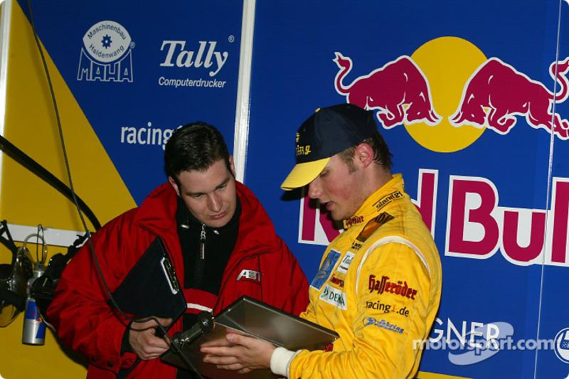 Martin Tomczyk y el ingeniero de carrera, Franco Chiocchetti