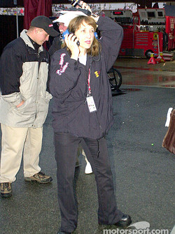 Claire B. Lange working on her NASCAR interviews for XM radio and dodging the rain