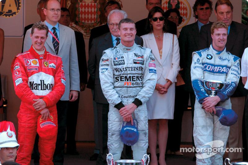 The podium: race winner David Coulthard with Michael Schumacher and Ralf Schumacher