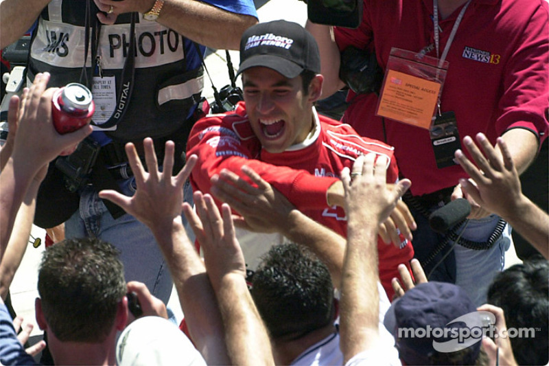 Castroneves throws himself into the crowd