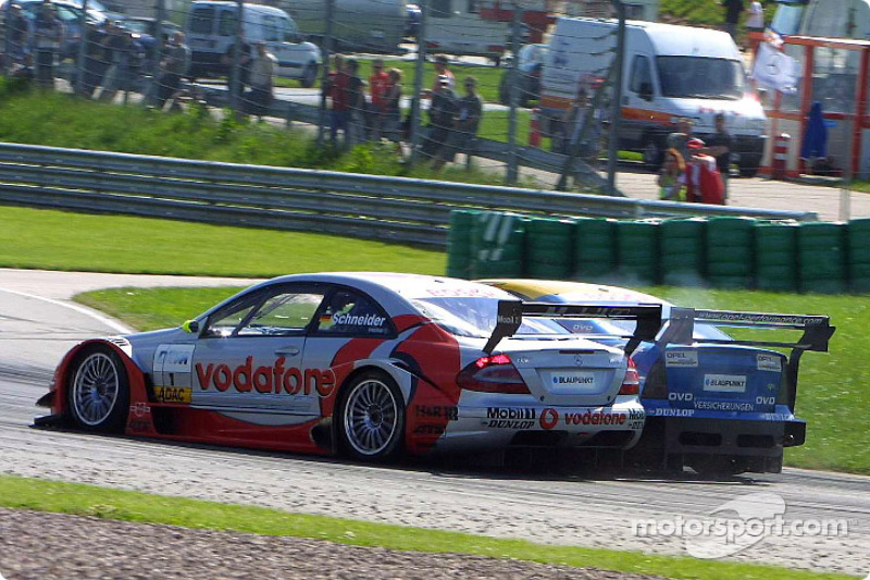 Bernd Schneider battling with Alain Menu