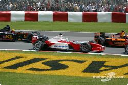 First corner: Allan McNish and Mark Webber