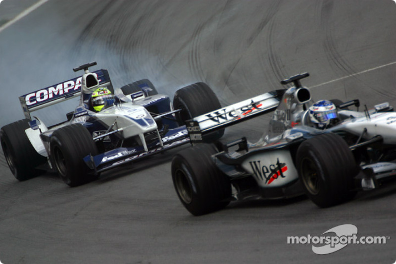 Kimi Raikkonen battling with Ralf Schumacher