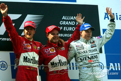 The podium: race winner Rubens Barrichello with Michael Schumacher and Kimi Raikkonen