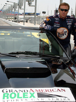Former-NASCAR Winston Cup champion Rusty Wallace poses by the Rolex Sports Car Series pace car he gave rides to the media in on Daytona's 3.56-mile road course