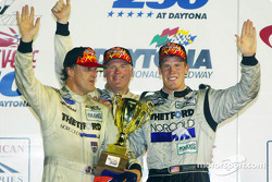 James Weaver (left), Rob Dyson (center) and Chris Dyson (right) celebrate their third-straight win in Daytona's Victory Lane