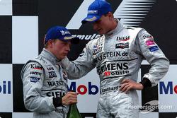 The podium: Kimi Raikkonen and David Coulthard