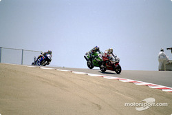 Nicky Hayden (69) leads Eric Bostrom (32) and Aaron Yates (20)