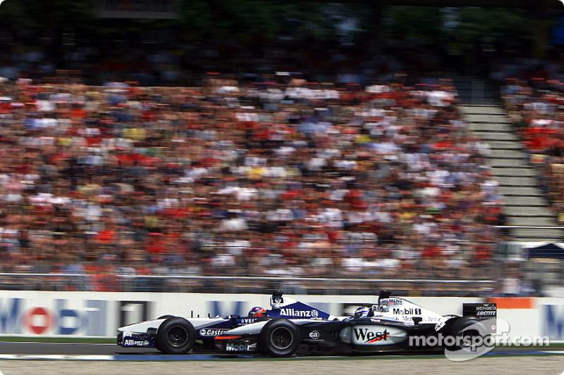 Kimi Raikkonen and Juan Pablo Montoya battling