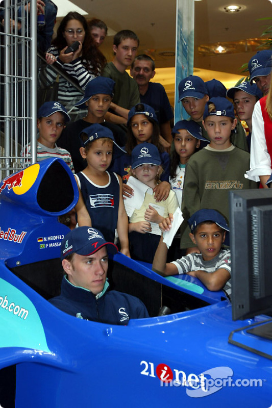 Nick Heidfeld meeting the children from the renowned