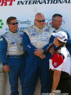 The LMP 675 podium: winners Jeff Bucknum, Bryan Willman and Chris McMurry
