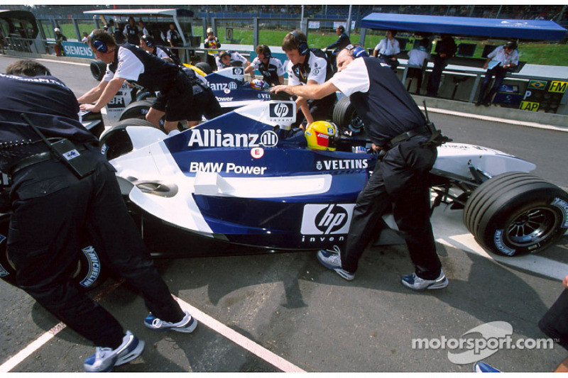 Ralf Schumacher and Juan Pablo Montoya back to the pits