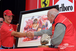 Michael Schumacher receives a gift for his 5th Driver World Championship from Froilan Gonzalez