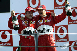 The podium: race winner Rubens Barrichello with Michael Schumacher