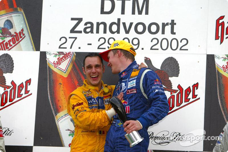 The podium: race winner Mattias Ekström with DTM 2002 Champion Laurent Aiello