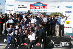 The podium: Rally winner and WRC 2002 Champion Marcus Gronholm with Harri Rovanpera and Team Peugeot celebrate