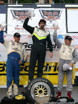 The podium: race winner and 2002 Trans-Am champion Boris Said with Butch Leitzinger and Stuart Hayner