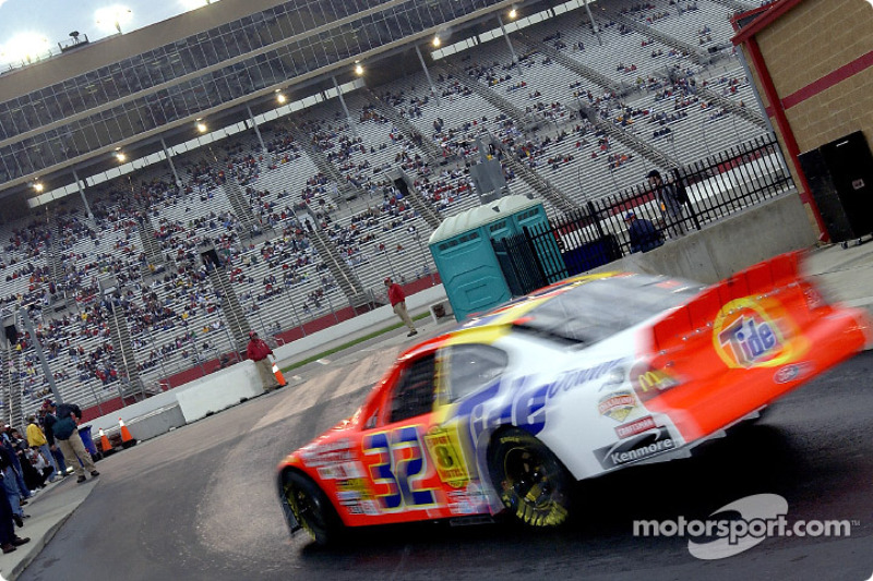 Ricky Craven heads out to the track following a rain delay