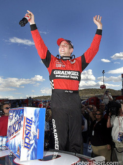 Greg Biffle climbs from the Grainger Ford Taurus after clinching the 2002 Busch Grand National Series Championship