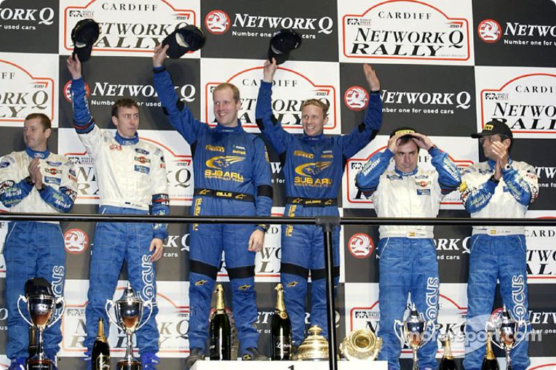Подіум: переможці Петтер Сольберг і штурман Філом Міллз, а також призери - екіпажі Маркко Мартіна та Карлоса Сайнса