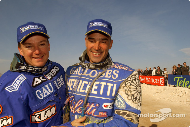 Winner Richard Sainct celebrates with Fabrizio Meoni
