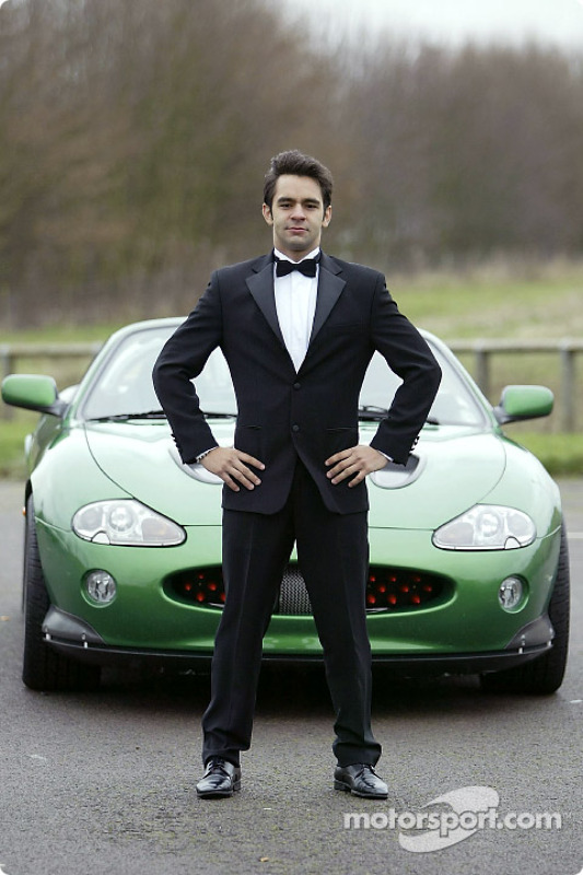 Antonio Pizzonia poses with the James Bond 007 XK-R during a photoshoot at the Jaguar Racing headquarters in Milton Keynes