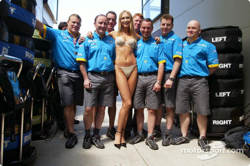 Wonder Bra model Marina Dior with a Renault F1 team member