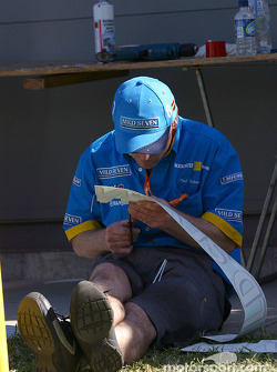 Renault F1 team member prepares decals