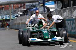 Jaguar team members push the Jaguar to technical inspection