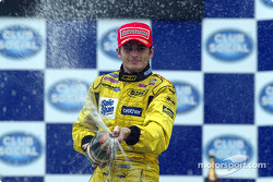 The podium: champagne for Giancarlo Fisichella